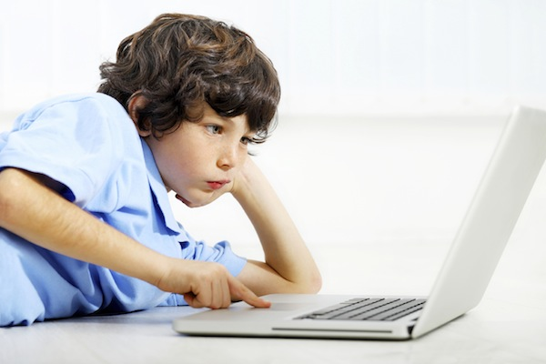 Portrait of a boy using laptop.