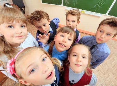 14052484 - happy schoolchildren at a classroom. education.