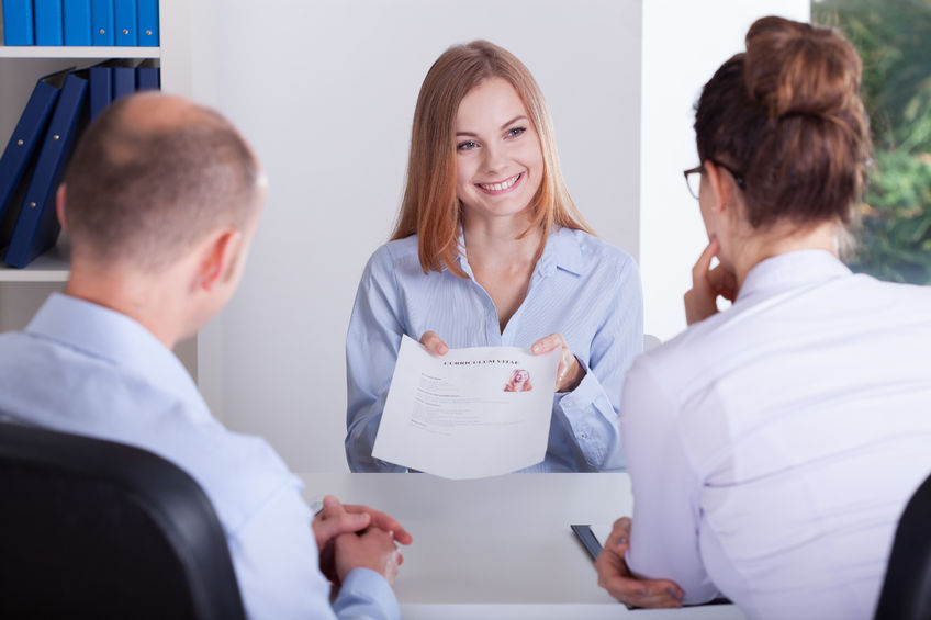 33091062 - young female candidate presenting her application on job interview